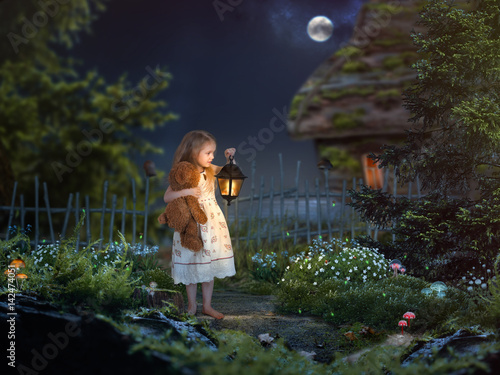 Valokuva  The little girl in the night in a beautiful magical forest