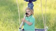 Beautiful funny little child wearing knitted pilot hat plays in handmade toy airballoon in nature landscape. Portrait of happy cute excited baby. Real time full hd video footage. Sequence of 2 cuts.
