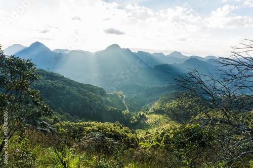 Fotobehang Groen blauw Mountain peak landscape green grass