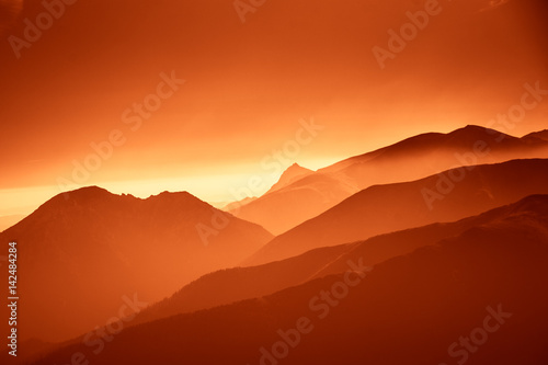 Spoed Foto op Canvas Rood traf. A beautiful, colorful, abstract mountain landscape in a red tonality. Decorative, artistic look.