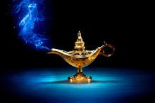 Magic Aladdin / Genie Lamp With Smoke On A Dark Background