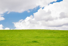 Grassy Hill With White Clouds ...