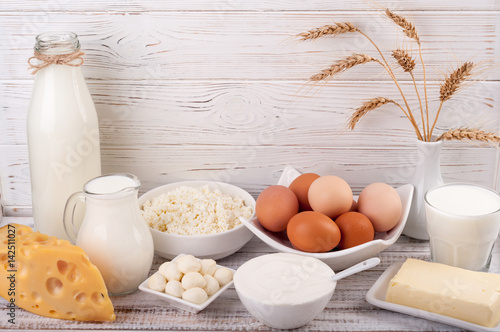 Poster Dairy products Dairy products on wooden table. Milk, sour cream, cheese, egg, yogurt and butter. Healthy food, diet concept. Copy space