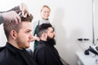 smiling men clients at hair salon