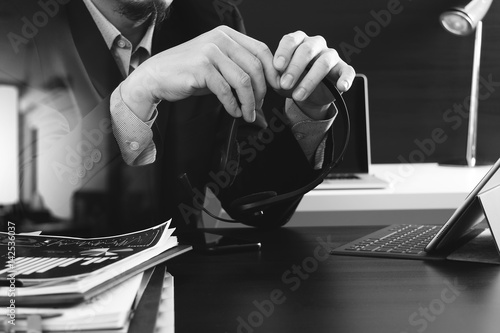 Fototapety, obrazy: Man using VOIP headset with digital tablet computer as concept communication or it support or call center and customer service in modern office