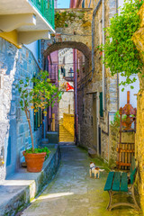 Fototapeta view of a narrow street waiting for tourists to come in corniglia, cinque terre, italy.