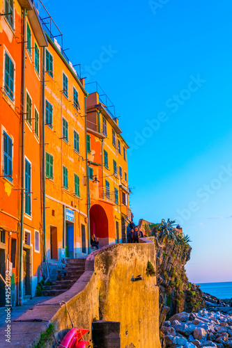 Tuinposter Liguria Riomaggiore village lit during sunset in Cinque terre, Italy.