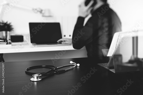 Fototapety, obrazy: Medical technology concept. Doctor hand working with smart phone,laptop,modern digital tablet dock screen computer in modern clinic office room,virtual screen medical chart interface