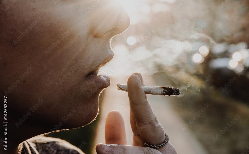 Fototapety, obrazy: Woman Smoking A Marijuana Joint