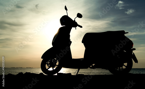 Silhouette scooter at seaside Wallpaper Mural