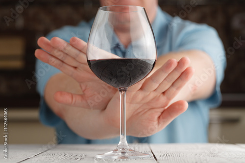 Spoed Foto op Canvas Bar Close-up Of male Hand Reject A Glass Of wine Offered