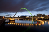 Gateshead Millennium Bridge light up at night,  over the Tyne river in Newcastle-upon-Tyne,