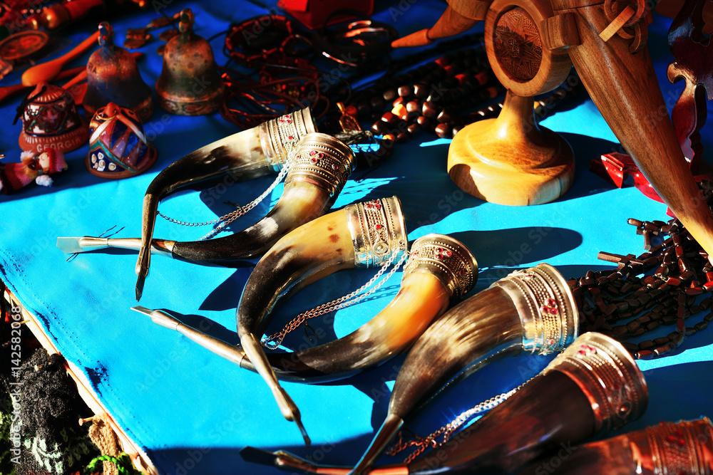 Fototapety, obrazy: Traditional Georgian horns for drinking wine (qantsi) handmade souvenirs at marketplace. Georgia.