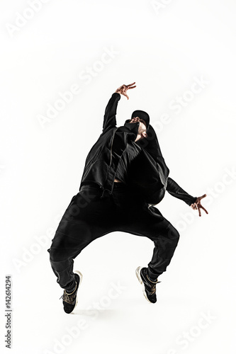 The silhouette of one hip hop male break dancer dancing on white background Canvas Print