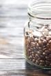 Glass jar of coffee beans