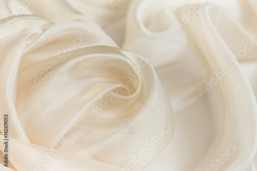 Fototapeta Wavy beige organza close-up