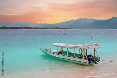 Traditional boat on Gili Meno island beach, Indonesia at sunset