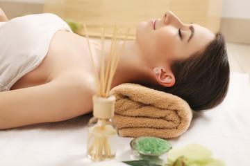 Obraz na płótnie Canvas Spa Relaxation. Woman Body Care. Beautiful Sexy Caucasian Brunete Girl In Bikini Lying In Resort Day Spa Salon. Beauty Treatment, Skin Care Therapy. Wellness. Healthy Lifestyle Concept