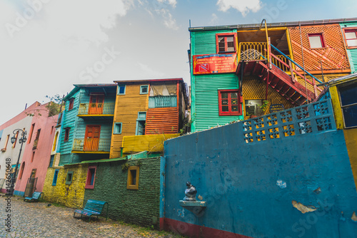Fotobehang Buenos Aires Traditional colorful houses on Caminito street in La Boca neighborhood, Buenos Aires. Stylized for film look