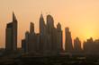 United Arab Emirates, Dubai, 07/02/2015, dubai marina dusty sunset cityscape silhouette at sunset. vibrant orange sky.