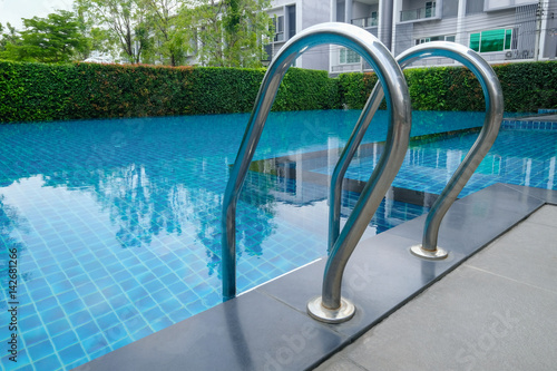 Pool ladder steps of a luxury public outdoor swimming pool ...