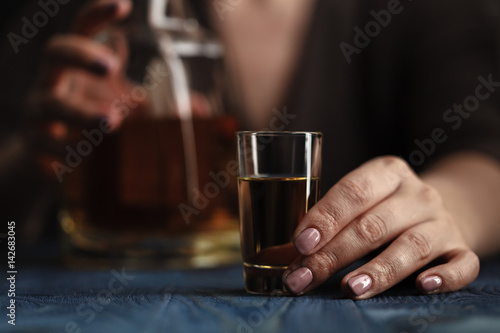 Poster Bar Woman sitting at home drinking way too much whiskey, she is addicted