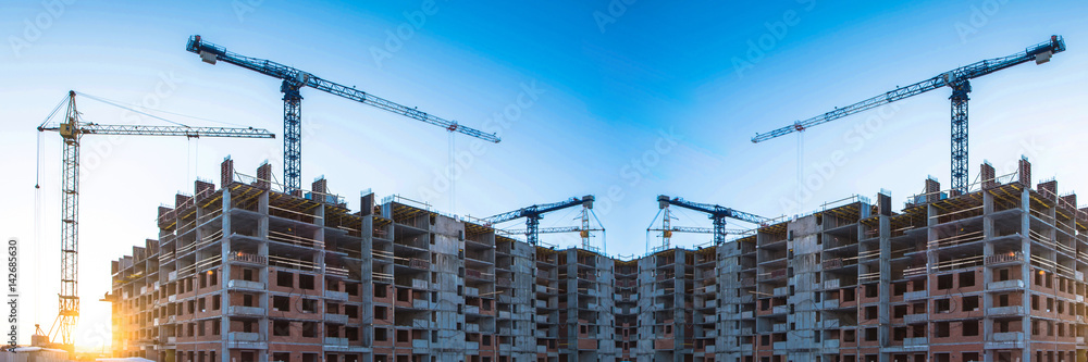 Fototapeta Panorama of construction at the background of blue sky