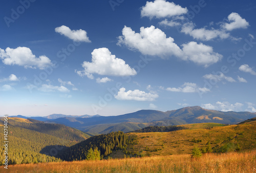 Foto op Canvas Nachtblauw Mountain landscape with a beautiful sky