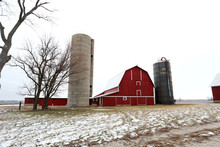 An Old Red Barn And Silos In The Snow In Illinois