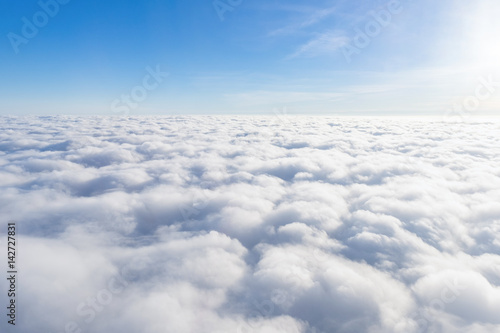 Obraz View from airplane window above the clouds - fototapety do salonu