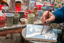 Pottery Artisan In Caltagirone, Sicily, Decorating Just Enamelled Square Tiles In His Work Table