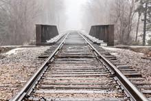 Train Tracks And Bridge In Win...