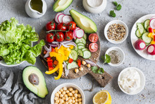 Ingredients For Spring Vegetable Salad. Delicious Healthy Vegetarian Food.  On A Gray Background, Top View