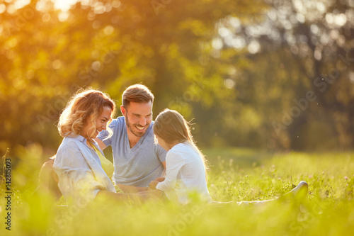 Parents with girl in green park