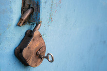 Old Rusty Lock With A Key On A...