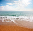 Sandy beach and the surface of the Mediterranean Sea under a beautiful sunny sky scenery