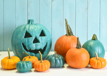 Teal And Orange Pumpkins In A Halloween Still Life Indicating That Both Allergy Safe Non Food Treats As Well As Candies Are Available To Trick And Treaters