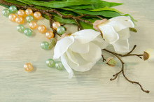 A Silk Magnolia Branch With Bath Beads