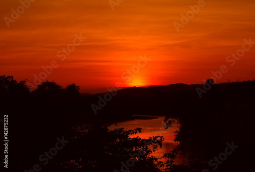Spoed Foto op Canvas Rood traf. sunset beautiful and silhouette tree colorful landscape in sky twilight time