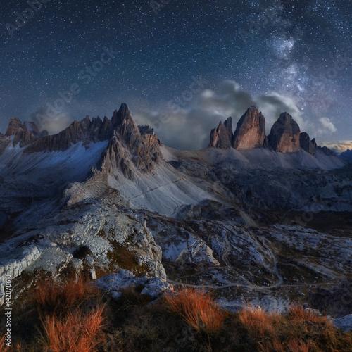 Fotografie, Obraz  Alps Mountain landscape with night sky and Mliky way, Tre Cime di Lavaredo, Dolo