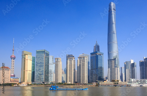 Photo  New Pudong skyline, looking across the Huangpu River from the Bund, Shanghai, Ch