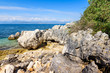 Picturesque rocky bay in Kassiopi village, located in northern Corfu. Greece.