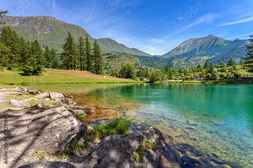 Small alpine lake among mountains.