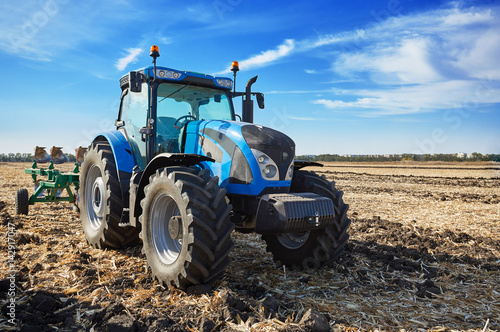 Tractor working in field Canvas Print
