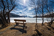 Wooden bench to admire the scenery on an alpine lake ice