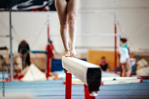 Vászonkép  female exercises on balance beam competitions in artistic gymnastics