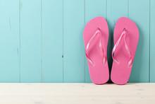 Pink Flip Flops On Wooden Back...