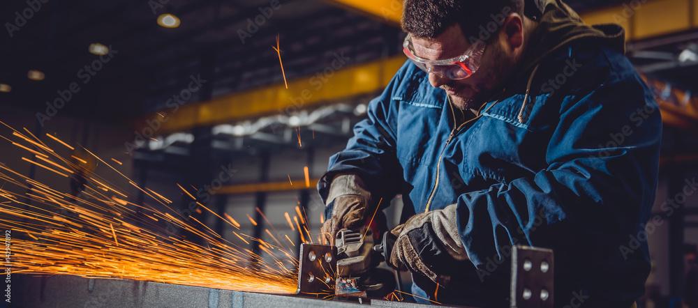 Fototapeta Worker Using Angle Grinder