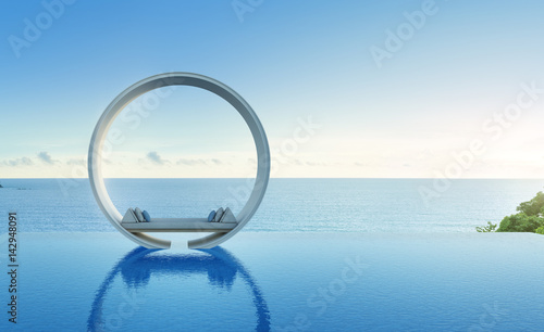 Photographie  Sofa and swimming pool in luxury sea view hotel - 3d rendering