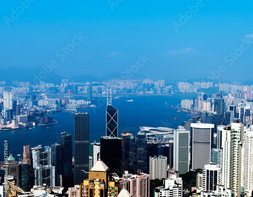 Hong Kong cityscape with victoria harbour and large group of tall buildings Poster